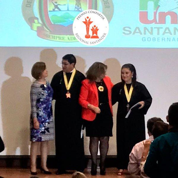 Premio para la mejor maestra y rector de Santander